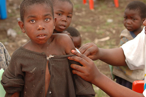 poor kid getting vaccinated