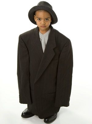 Boy in too large suit