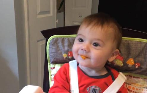 Baby trying solid food for the first time