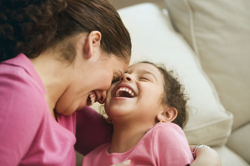 mom laughing with child