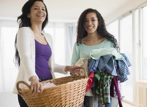 Mother and daughter with laundry